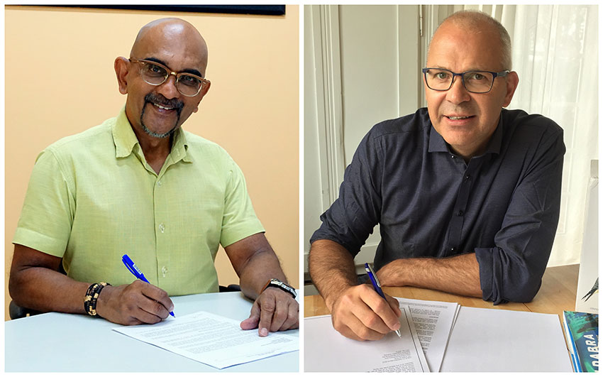 Dr Nirmal Shah L and Dr David Richardson R signing an MOU remotely for the Seychelles Warbler Research House